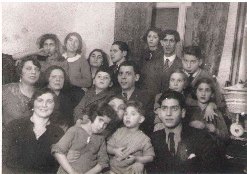 [photo 1: family gathering. Muis is the young man at right in the front row.]