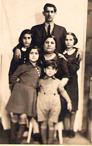 [Photo 2: Josef Mentesch, Lea Meshoulam-Jahisch and four of their five children: Rebeka at back left, Rachel at back right, Rosa at front left, Albert at front]